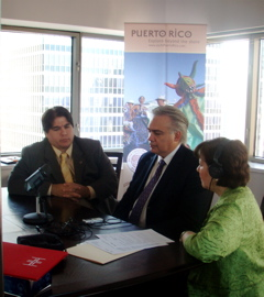 Doris Gilman (right) Interviews (left to right) Armando Rodriguez and Milton Segarra of HIMAHEALTH.